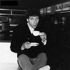 Welsh singer Tom Jones drinking tea at the airport, 1965. His official title is Sir Thomas John Woodward, OBE. Since the mid-1960s, Jones has sung nearly every form of popular music – pop, rock, R, show tunes, country, dance, soul and gospel – and sold over 100 million records.