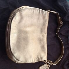 Metallic Gold leather Coach bag Metallic Gold coach bag.  Has internal zip pocket as well as 2 other smaller pockets.  Very soft leather. Love this bag only selling because I need to downsize.  If this bag doesn't sell I will not be disappointed. Coach Bags Shoulder Bags