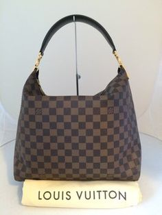 Louis Vuitton Portobello Pm Shoulder Bag. Get one of the hottest styles of the season! The Louis Vuitton Portobello Pm Shoulder Bag is a top 10 member favorite on Tradesy. Save on yours before they're sold out!