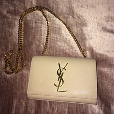 Fairly new ysl chain bag. PERFECT condition Barely worn. Prefect condition YSL clutch with gold chain. Just too small for me and already bought the bigger size in same nude color. Very rare nude color. NO TRADES. Less thru ️️ Saint Laurent Bags Crossbody Bags