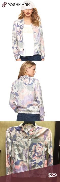 """New Juicy Couture Floral Bomber Jacket Brand new with tags.  Discover the trendy appeal of this women's Juicy Couture bomber jacket Retro styling and unique twill construction combine to give your wardrobe a modern edge PRODUCT FEATURES ·   Ribbed neck, hem, cuff ·  Zip front with """"J"""" logo pull ·  Long raglan sleeves ·  Faded floral pattern ·  Two slip pockets Juicy Couture Jackets & Coats"""