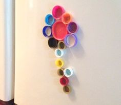 Bottle cap fridge magnets! Who needs letters when your kids can make shapes with this easy craft tutorial.