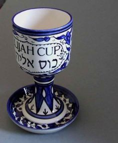 Elijah Cup for Passover Night, Eliyahoo Cup, Armenian Ceramics Blue Design . $46.00. Elijah Cup (Kos Eliyahu) & Coaster Blue Flowers design. Height:Cup 17.5cm. Diameter:Cup 9, Coaster 12cm. Elijah Cup (Kos Eliyahu) & Coaster Ornate Elijah Cup (Eliyahu) Blue Flowers design Hand painted glazed Ceramic Height:Cup 17.5cm Diameter:Cup 9, Coaster 12cm  Eliyahu, or Elijah, a biblical figure who, at Passover, is believed to make an appearance at every Jewish family's seder ...