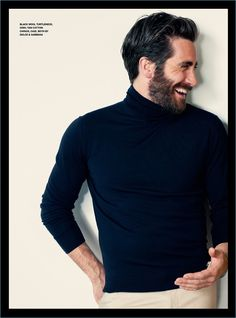 All smiles, Jake Gyllenhaal wears a black turtleneck and tan chinos by Dolce & Gabbana.