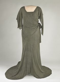 Lou Hoover's Evening Gown  Dark grey silk crepe evening gown with metallic thread brocade.
