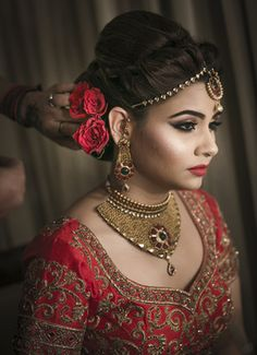 Bridal Portrait - Bride in a Gold Choker Set with Maang Tikka   WedMeGood #indianbride #indianwedding #bridal #indianjewelry #jewelry #red #flowers #choker