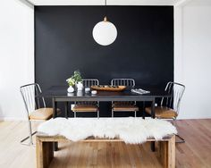 """""""Since the living, dining, and kitchen are all one continuous space, we added the accent wall to define the dining area."""" West Elm Emmerson Reclaimed Wood Dining Bench ($499)."""
