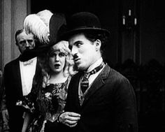 Charlie Chaplin- Oh, no, we're not married:  Idle Class, 1921