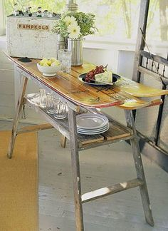 Old wooden skis + vintage ladder makes an awesome table for the lake!