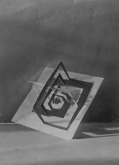 Josef Albers Discussing Paper Sculptures presented by His Students during the Preliminary Course at the Bauhaus, Dessau, Germany