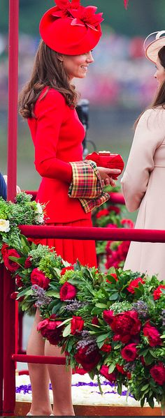 Kate dressed in a striking red Alexander McQueen outfit for the Queen's Diamond Jubilee Flotilla, June 3, 2012.  She is gorgeous in red!!