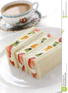 Photo about Sandwich with fresh fruits and cream filling and a cup of milk tea. Image of colorful, meal, sweets - 23641523 tea party sandwiches Fruits Sandwich And A Cup Of Tea Stock Image - Image of mango, bread: 23641523 Sandwich Torte, Fruit Sandwich, Tea Sandwich Recipes, Cucumber Cream Cheese Sandwiches, Sandwich Appetizers, Tea Party Sandwiches, Finger Sandwiches, Afternoon Tea Parties, Afternoon Tea Recipes