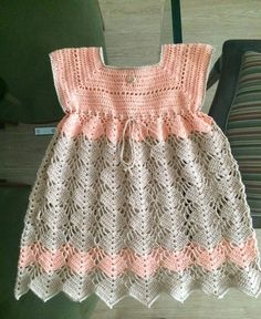 Hand crochet/crocheted dress for your special little girl. This dress also has a pearl button closure on the neckline, and the yarn has a sparkly thread through the whole dress. This would be perfect for a one of a kind Christening/Baptism dress. Crochet Dress Girl, Crochet Baby Dress Pattern, Baby Girl Dress Patterns, Knit Baby Dress, Baby Girl Crochet, Crochet Doll Clothes, Baby Girl Dresses, Baby Knitting Patterns, Crochet For Kids