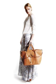 Our Classic Thela Tan Tote Bag carried rather fetchingly. www.youngbritishdesigners.com