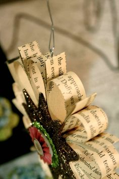Ornaments made with strips of pages from a book. Could use newspapers, funny pages, sheet music, all kinds of paper.....