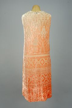 Ombreed and voided velvet dinner dress, Sleeveless pale pink silk deepening to salmon at hem, cut to nude voile in a geometric pattern, neckline trimmed in beaded lace, rhinestone studded insert, dropped waist with smocked front panel, 1920s