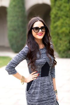 Grey and black dress with red lipstick and nails