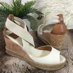 """Tory Burch ivory canvas strap cork wedges. Tory Burch ivory canvas strap cork wedges.  Beautiful raffia trim soles adds a great touch. Gently loved with really only wear to insole where your foot covers otherwise wonderful condition. Insoles measure 9 3/4"""" long for reference. 3 1/4"""" heel height including 1"""" platform. Camel color leather heel cap with engraved TB logo Tory Burch Shoes Wedges"""