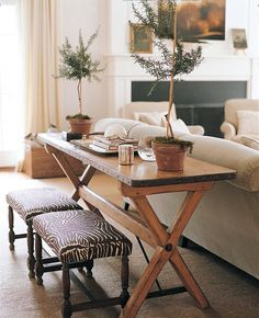 Love me some rustic topiaries and cross-legged furniture