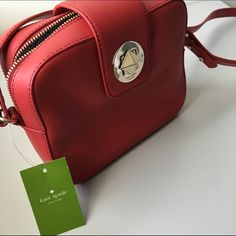 "Kate Spade Chrystie Street Isla Gorgeous Kate Spade Chrystie Street Isla shoulder bag in Pillbox red. Add a pop of color to any outfit with this gorgeous shade of red.   Shoulder bag with zip top and signature turn lock closure  Zip closure, custom lining, and interior zip pocket  Red leather strap with a 20"" drop  Measures approximately 8"" L x 6.5"" H x 2.75"" D  MSRP: $298.00 kate spade Bags Shoulder Bags"