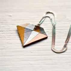 This DIY geometric diamond necklace is super easy and fun to make, and costs almost nothing.