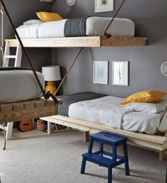 Floating Beds - The gender neutral color palette (yellow, grey, and white) makes the room flexible enough for a teen or gradeschooler to share with two to three other siblings.