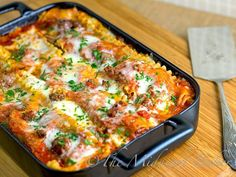 Trying tonight... Holiday Lasagna is a traditional casserole served for Christmas Eve Dinner.  Great for buffet parties too.