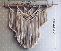 Large macrame hanging decoration for the wall in the living room, bedroom or hallway will add interior design and make it unique. Macrame wall decor looks like a necklace and will please residents of the house and guests. The central part of the wall hanging is decorated with gold sparkles