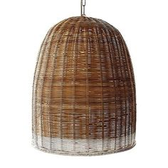 Three appealing woven wicker pendant lights–with a $600 price difference. Above: The Basket-Weave Pendant Lamp (22 inches high) made from rattan with an ir