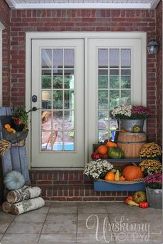 Fall Porch Decorating Ideas- back porch with a farmers market feel- piles of pumpkins, gourds and mums in vintage decor.