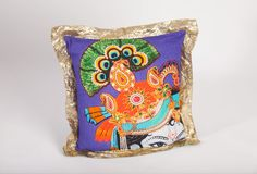 Square Shri Krishna Cushion (infill included) :  Fresh and bright, this Shri Krishna pillow with gold lace edging pops with its rich, dynamic pattern.