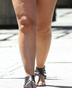 Flats and ankle straps make legs appear thicker and heavier. Wear a thicker stacked heal, wedge or platform shoe to balance out heavy legs. Avoid skinny stilettos that create too much contrast between leg and heal.