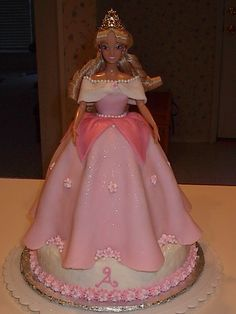 "Sleeping Beauty Disney Princess Aurora 3D Doll cake stand up - This was a doll cake for a 4th birthday party.  Birthday girl's name starts with ""A"" and she wanted Aurora hence the initial on the cake. 9"" Round supports a bowl baked caked (pampered chef lg mixing).  Cakes covered in buttercream, dress of fondant, flowers pre-piped in royal icing and edible pearls.  The doll was part of the gift, wrapped her legs in plastic wrap."