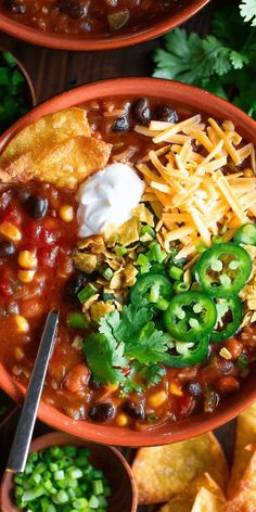 This one-pot Vegetarian Enchilada Soup is simply the best! Each bowl is loaded with tasty veggies, beans, and rice, then topped with all your favorite toppings for tons of flavor in every bite. #vegetarian and #glutenfree with a #vegan option too!