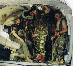 """johanvandemerwe: """" Executive Outcomes, Sierra Leone Notice the Rhodesian paint on the AK and the 2 pairs of Rhodesian vellies."""