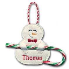 'Snowman Candy Cane Holders - Stitch darling little Snowman Candy Cane Holders that double as Christmas Tree Ornaments! They're so fast and easy to stitch, right in the hoop of your embroidery machine, and are sure to warm the heart of someone special. Hoop Size: 4x4 www.PicklePieDesigns.com