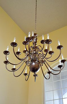 Re-do a shiny (bright) brass chandelier with paint!