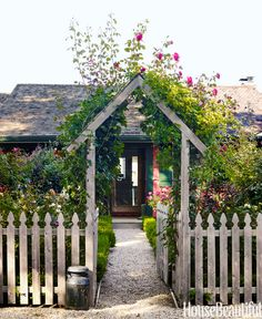 A rose-covered archway frames the front door of Podge Bune's Hamptons cottage. Pin it now >> - HouseBeautiful.com