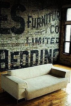 exposed brick with big chunky vintage lettering