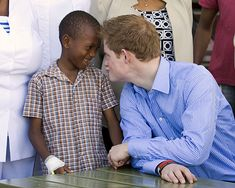 Prince Harry ~ He is his mother's son. Love this pic!