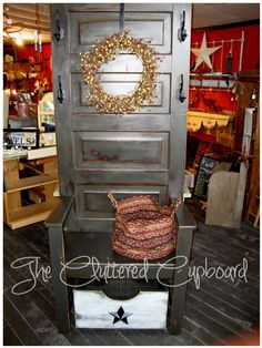 An old door we transformed into a hall tree / seat with storage box on casters - perfect for storing mitts, hats, etc.  A great piece for a porch / mud room.