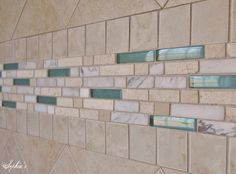 Glass and stone give the feeling of the beach to the bath...