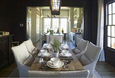 dark dining room with light furniture