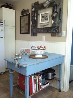 Antique kitchen table turned kitchen island...reclaimed pallet wood used for shelf... Farm house kitchen decor