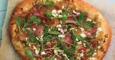 SPICY HONEY CARAMELIZED ONION PIZZA WITH PROSCIUTTO, FETA, AND ARUGULA