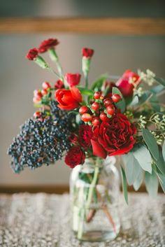 small floral arrangement in glass vintage vase #tabledecor #weddingreception #weddingchicks http://www.weddingchicks.com/2014/02/13/spicy-love-wedding-inspiration/