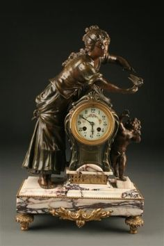 19th Century French statue clock with marble plinth, circa 1870. #antique #clock
