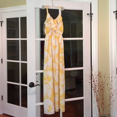 LOFT Maxi Dress NWOT LOFT yellow floral maxi dress!! NEVER BEEN WORN!! Size 00, adorable ruffle detail at top, synched waist, free flowing material, still has hanger strings!! SO CUTE, just doesn't fit me!! LOFT Dresses Maxi