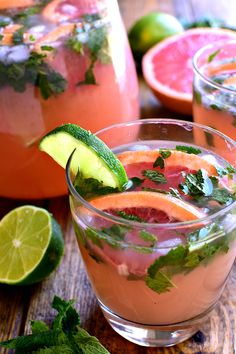 If you love grapefruit...and cocktails...these Grapefruit Mojitos are for YOU! A delicious twist on the classic mojito recipe, these Grapefruit Mojitos combine grapefruit juice, lime juice, fresh mint, and rum in a refreshing drink that\'s sure to have you saying, \