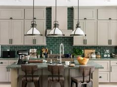 Part of the home's great room, the warm and user-friendly open kitchen pulls in the rich colors seen in the landscaping that surrounds the property for a woodsy chic look and feel.